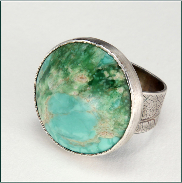 ring with round cabochon