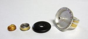 ring with tube rivet setting